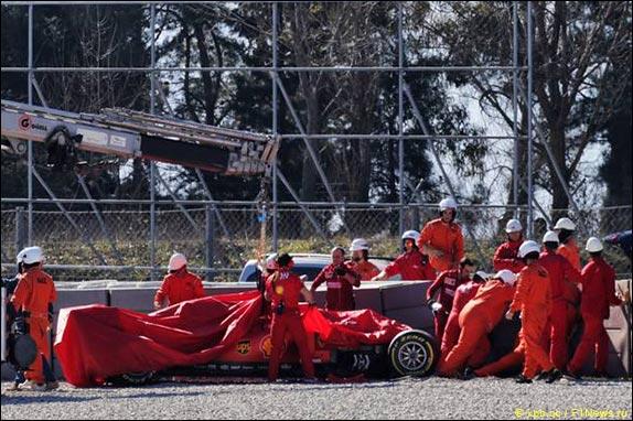 A broken car move Sebastian Vettel