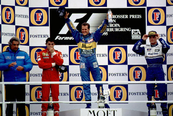 Флавио Бриаторе, Жан Алези, Михаэль Шумахер и Дэвид Култхард на подиуме Гран При Европы 1995 года