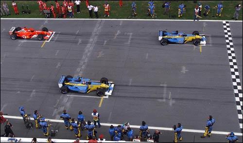 Фернандо Алонсо, Ярно Трулли и Михаэль Шумахер на стартовом поле Гран При Малайзии 2003 года