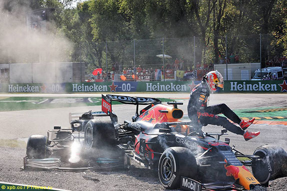 Max Verstappen leaves cockpit after collision with Lews Hamilton