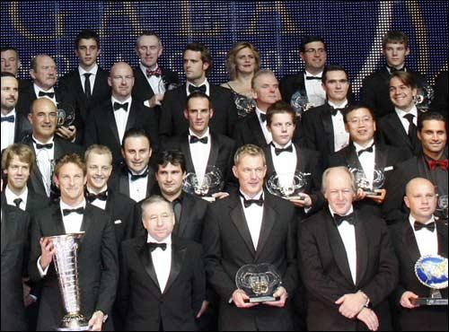 Михаил Алешин на церемонии FIA (второй справа во втором сверху ряду)