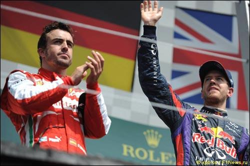 Фернандо Алонсо и Себастьян Феттель на подиуме Гран При Канады