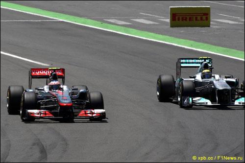Дженсон Баттон обгоняет Нико Росберга на трассе Гран При Европы