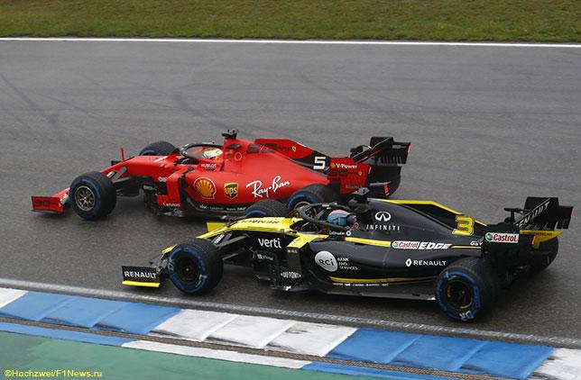 Машины Ferrari и Renault на трассе в Хоккенхайме
