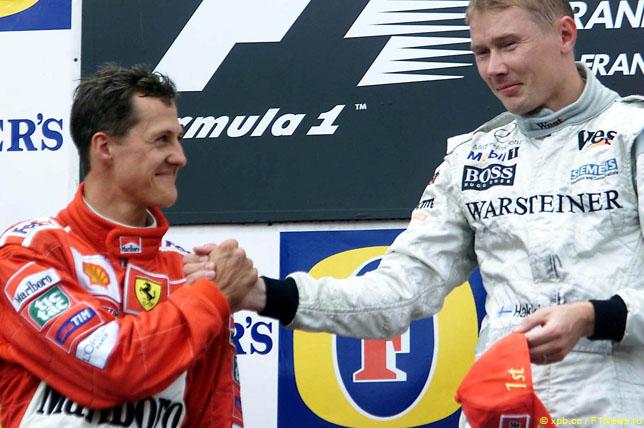 Михаэль Шумахер и Мика Хаккинен на подиуме Гран При Бельгии, 2000 год