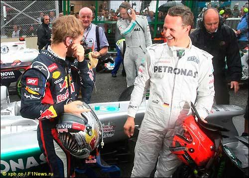 Себастьян Феттель и Михаэль Шумахер после финиша Гран При Бразилии