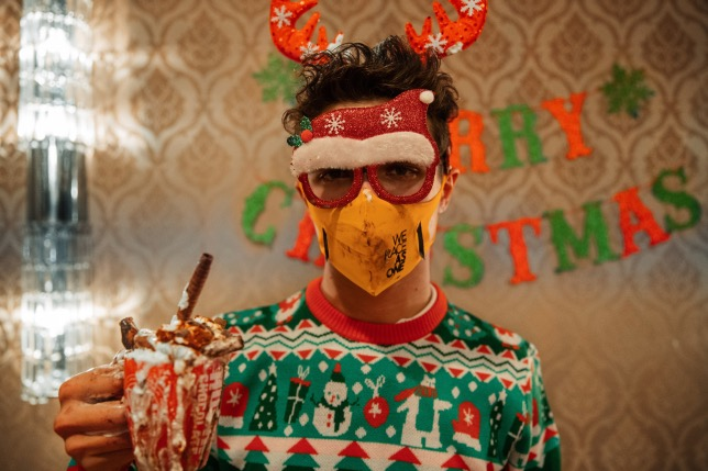 Ландо Норрис в рождественском наряде, фото из Twitter McLaren