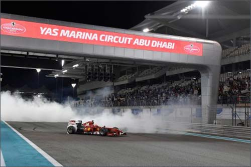 Кими Райкконен за рулём Ferrari F60 на трассе в Яс-Марине