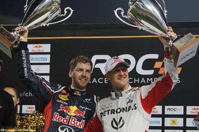 Себастьян Феттель и Михаэль Шумахер после победы в Кубке Наций на Гонке Чемпионом в Бангкоке, 2012 год